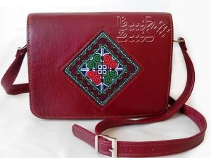 کیف زنانه چرم و سوزن دوزی